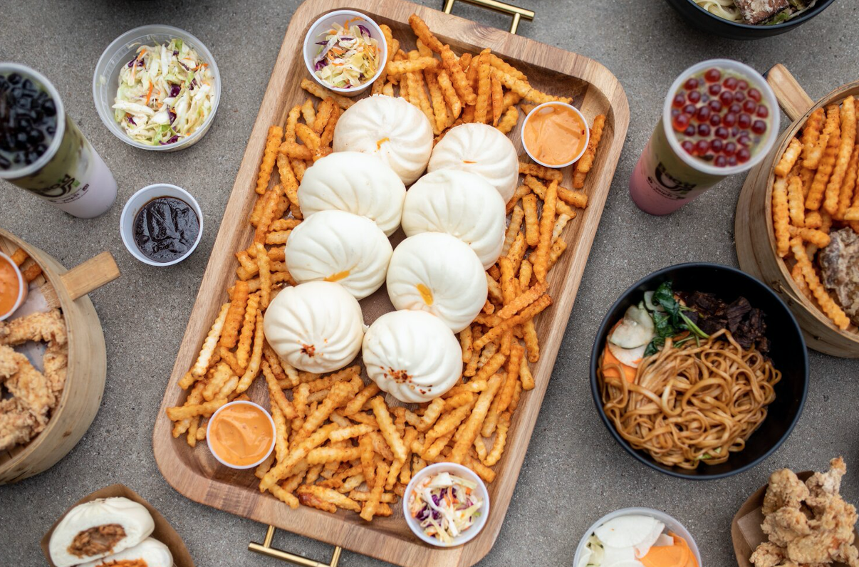 Bao Buns laid on top of french fries from Bao'd Up, the last of our quick-eat options in Downtown Austin.